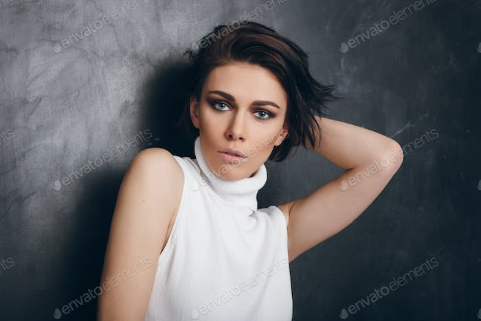 Young attractive fasion woman. Lifestyle portrait