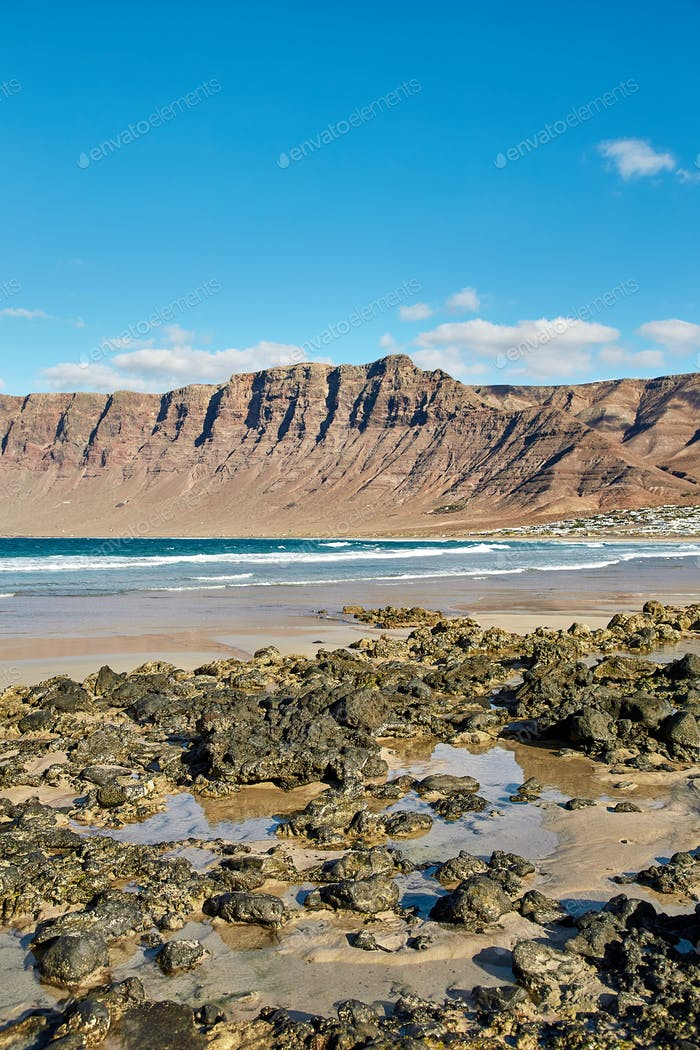 Landscape with volcanic hills and atlantic ocean in Lanzarote