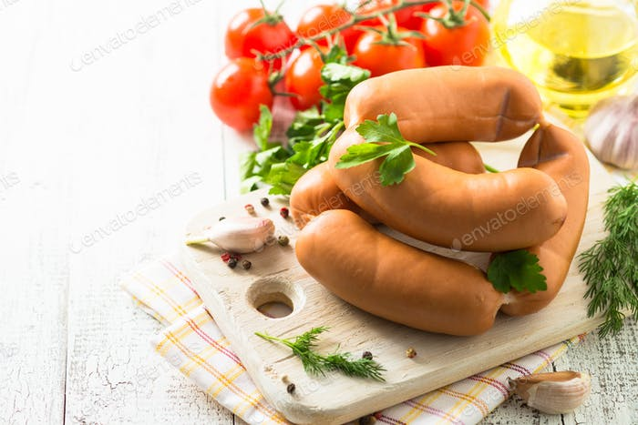 Uncooked sausages with vegetables