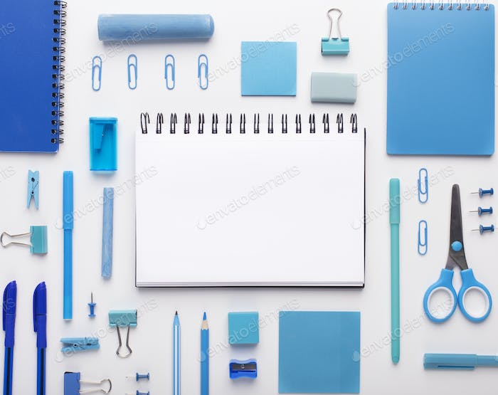 Blue colored office stationery, notepad with blank space on white