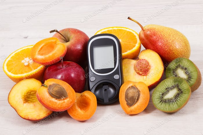 Glucometer and fresh natural fruits containing vitamins for healthy lifestyles of diabetics