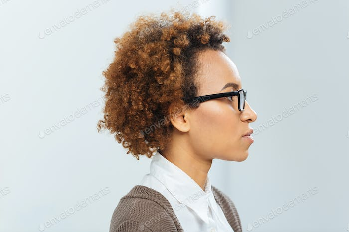 Profile of african american businesswoman in glasses