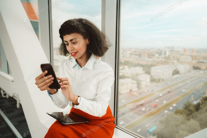 A woman-entrepreneur near the window