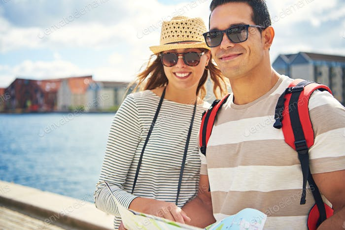 Happy young couple on a backpacking holiday