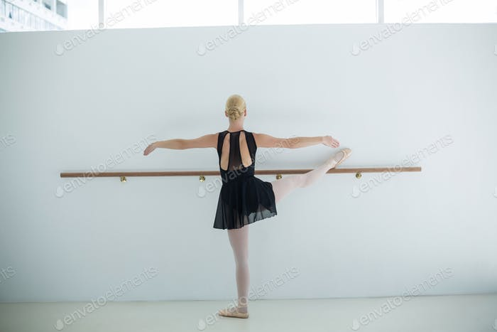 Ballerina practicing ballet dance in the studio