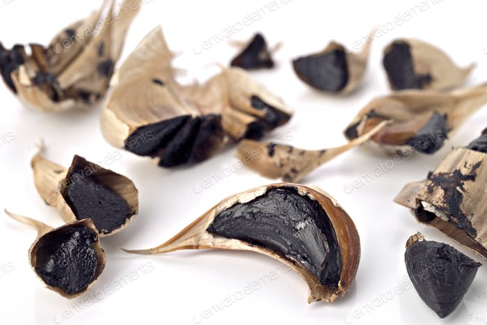 aromatic black garlic isolated on white background