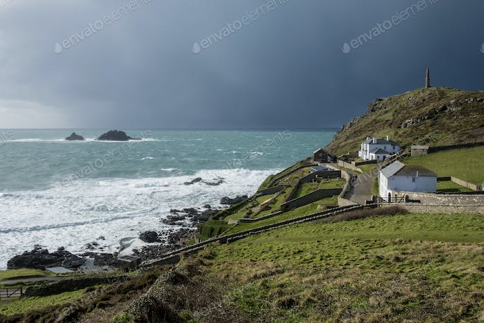 Cot Valley, St Just, West Cornwall coastline. View of cottages overlooking the coast and the Brisons