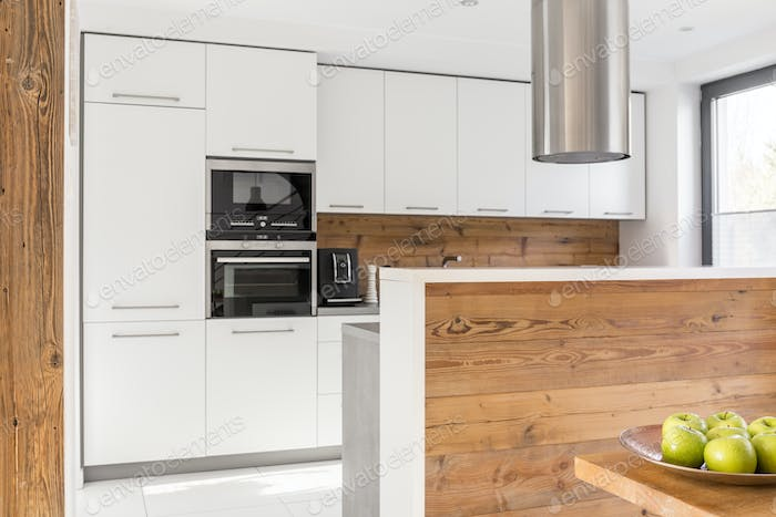 White cabinets and wooden panels
