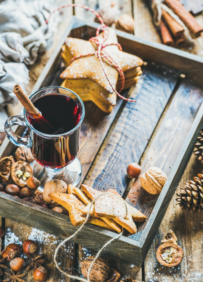 Glass of mulled wine, gingerbread cookies and spices, copy space