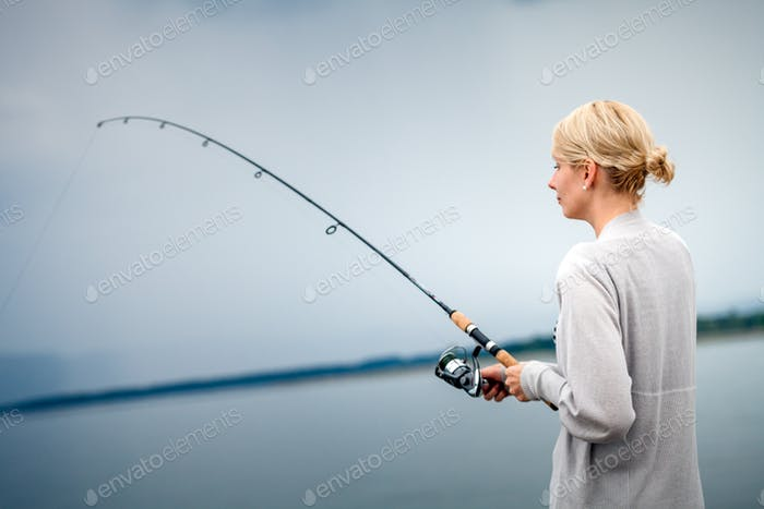 Young Woman Fishing Mackerel in Vacation