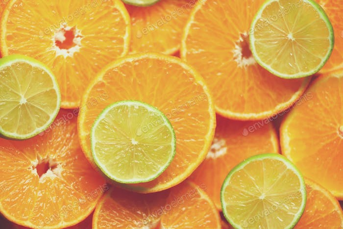 Fresh sliced orange fruit texture. Macro, top view, copy space. Food frame. Juicy oranges and lime