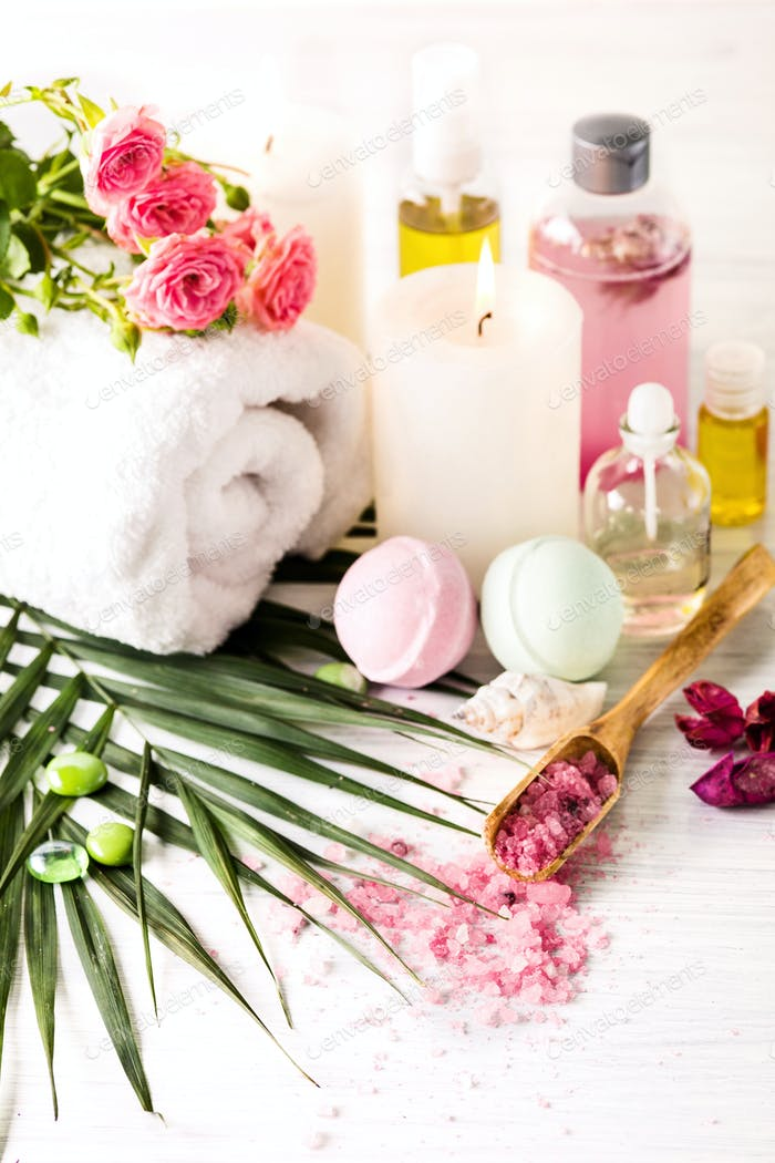 Spa setting with pink roses and aroma oil, vintage style