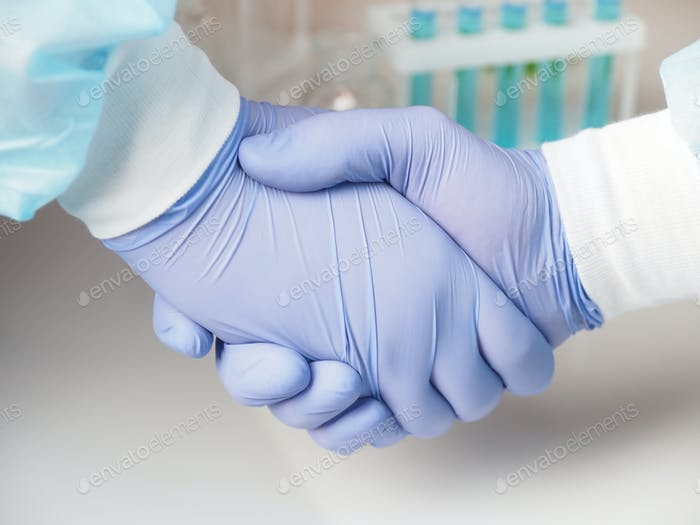 Handshake in medical gloves