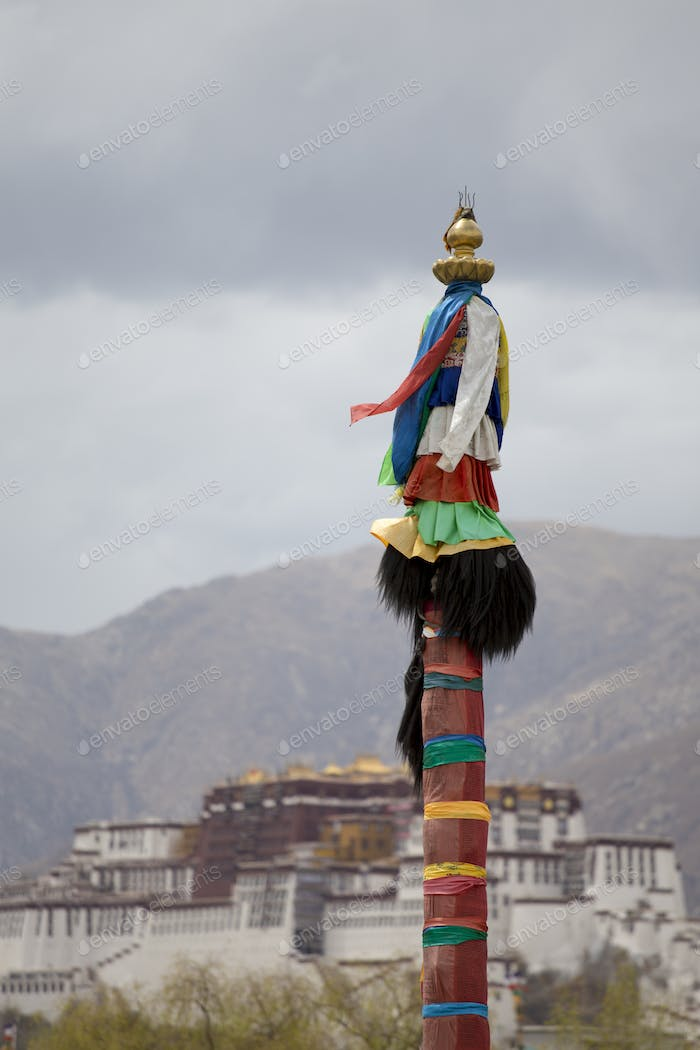 Religious Tibetan symbol with the Potala Palace, Lhasa