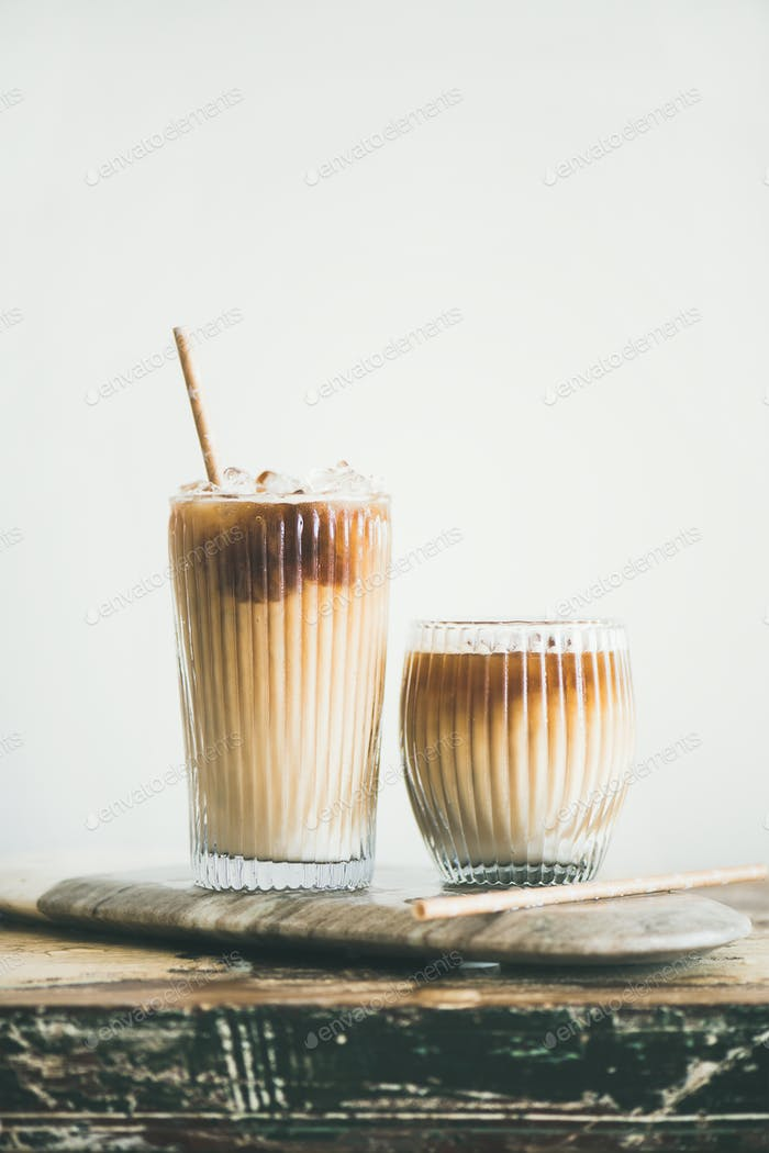 Iced coffee drink in tall glasses on board