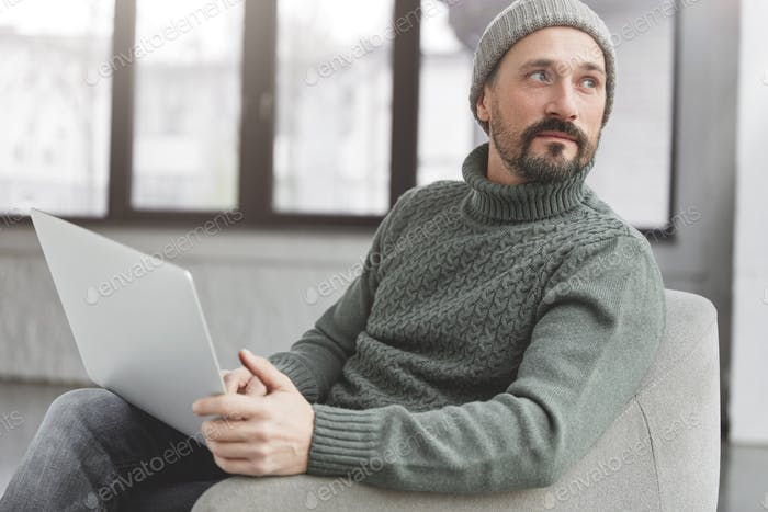 Professional marketing expert browses information on internet websites, uses laptop computer and wir