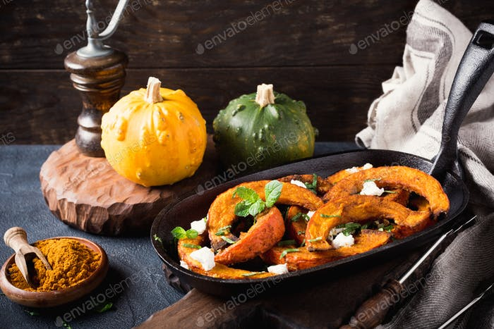Baked pumpkin with goat cheese and mint