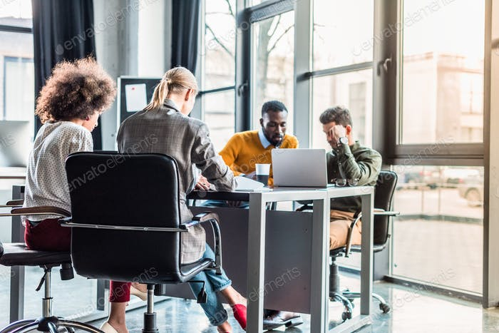 pensive multicultural businesspeople at meeting in office