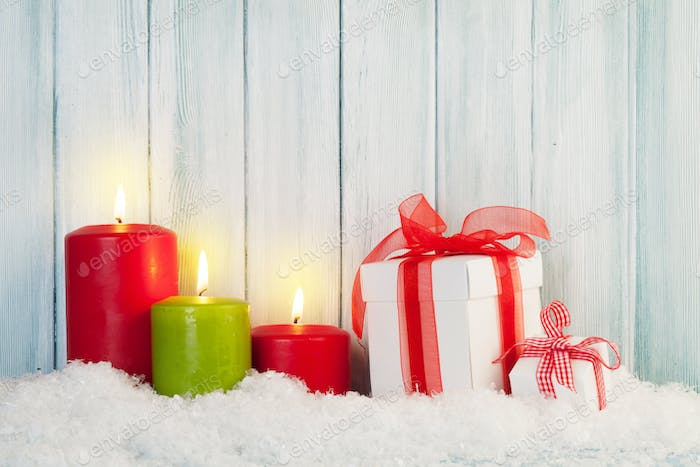 Christmas background with candles and gifts