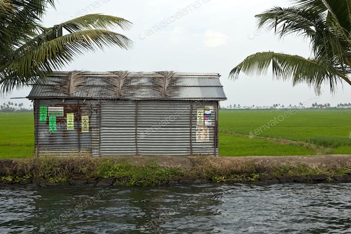 48336,A small barn or house on the edge of a waterway or backwater,