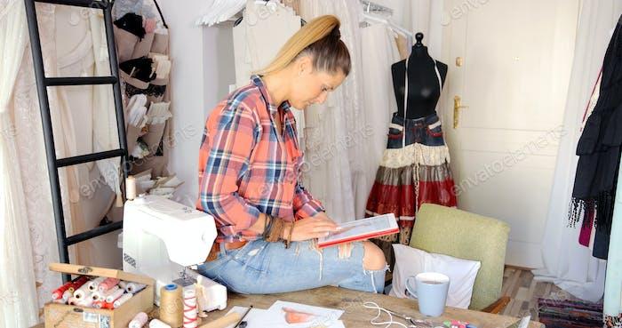 Female tailor using tablet