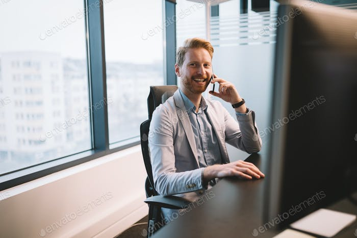 Portrait of attractive businessman in his office