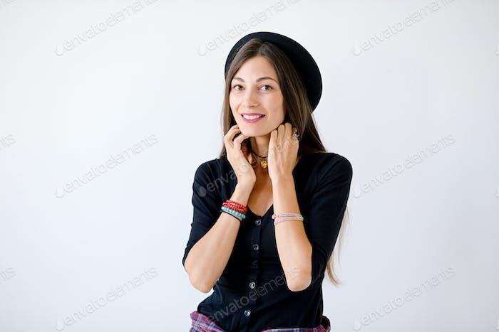 Smiling fashion hipster woman  studio shot