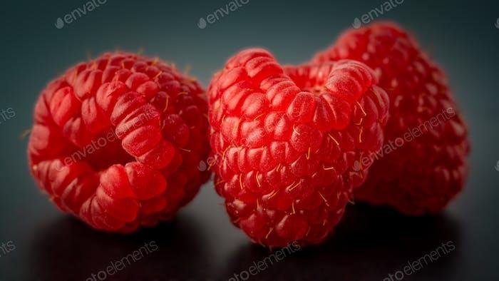 Delicious Raspberries on black background