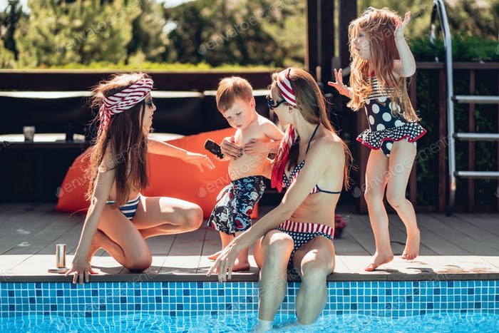 happy family having fun time at the pool side