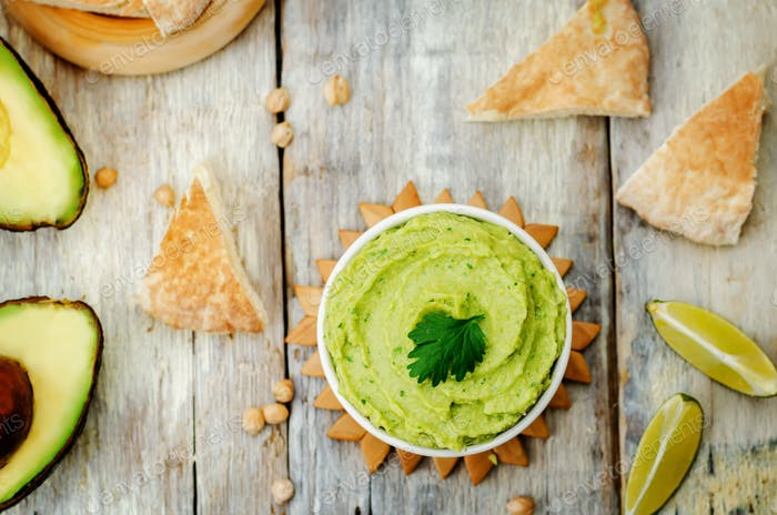 avocado hummus with pita and fresh avocado slices