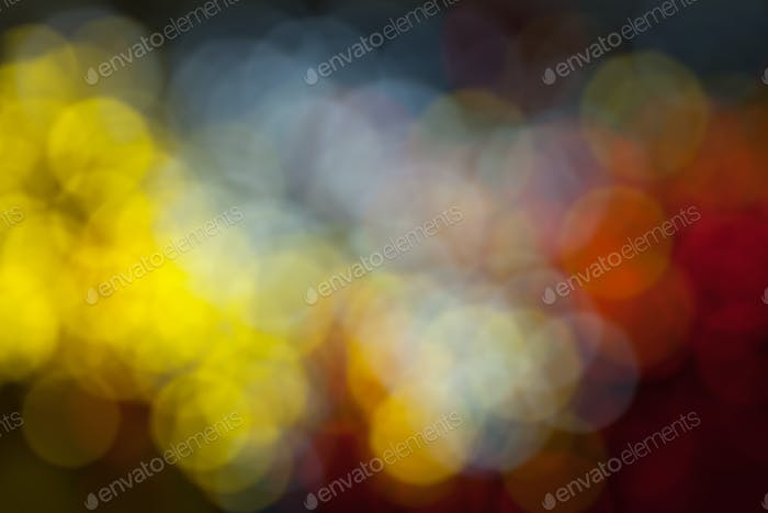 Background of multicolored blurred festive lights