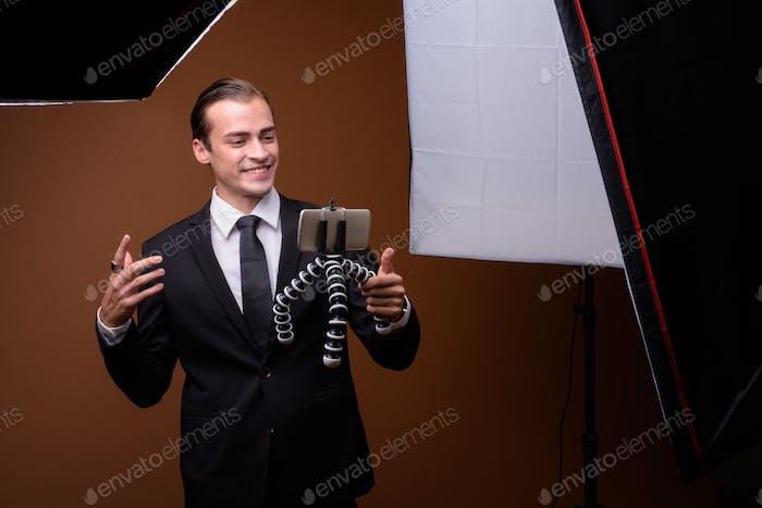 Portrait of young Caucasian businessman wearing suit