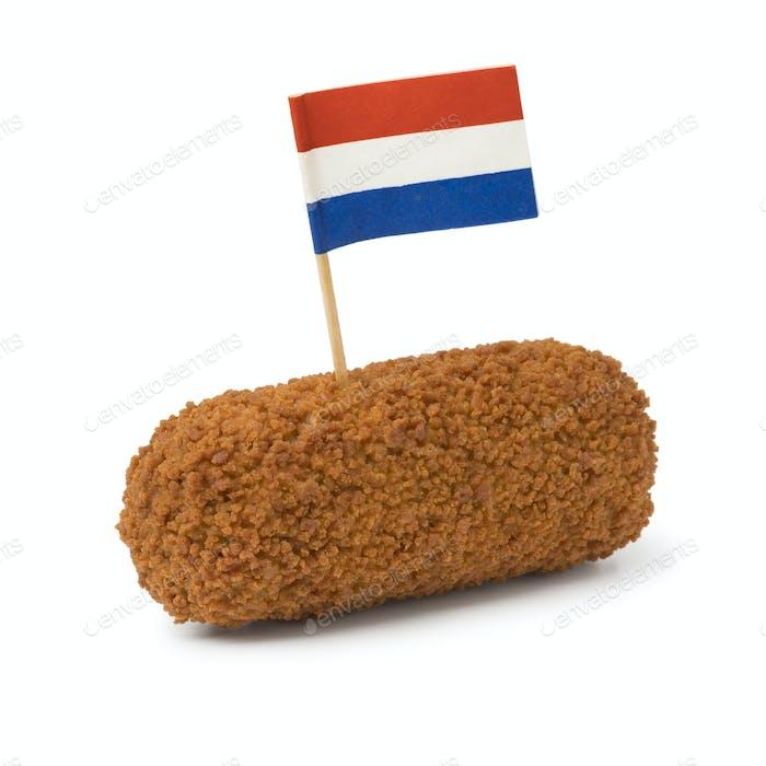 Single deep fried Dutch kroket with a Dutch flag