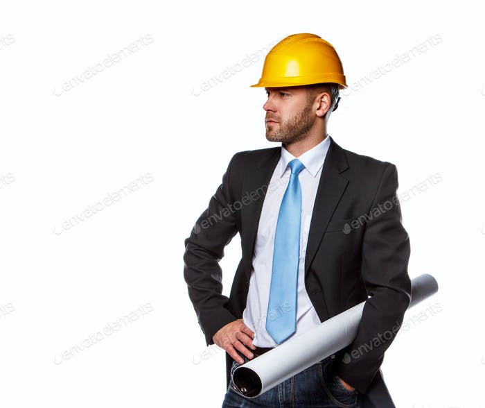 A man in a suit and safety yellow helmet.