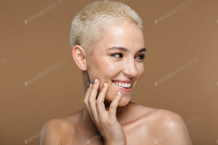 Smiling young blonde stylish woman with short haircut