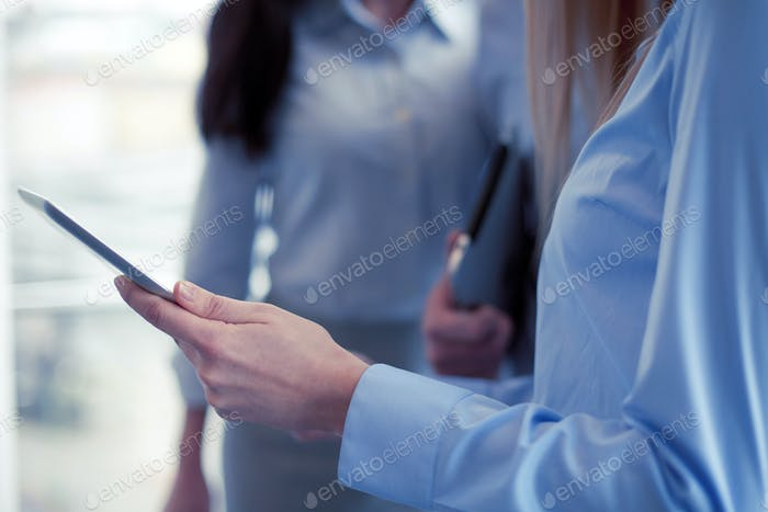 close up of business team with tablet pc in office