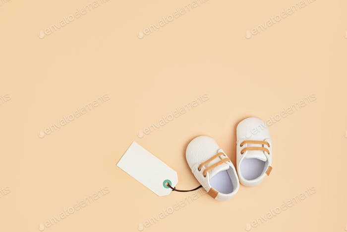 Gender neutral baby shoes with mockup tag