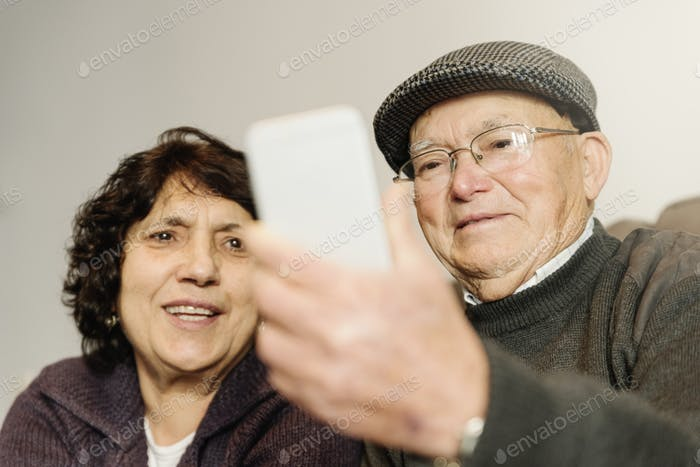 Senior rmarriage using his mobile phone.
