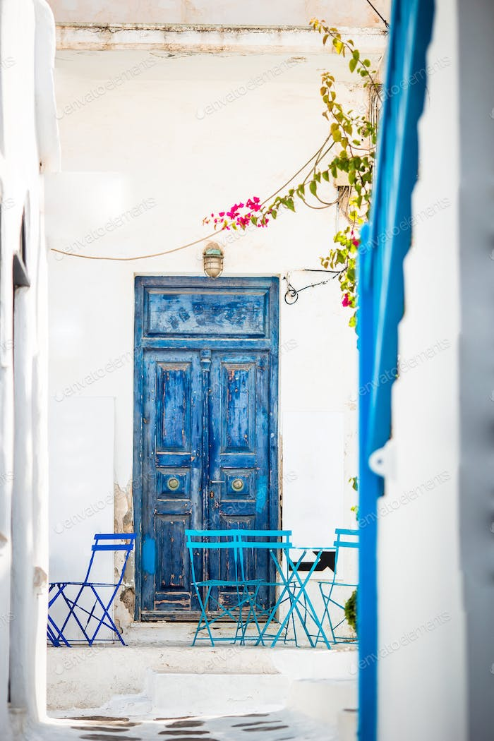Outdoor cafe on a street of typical greek traditional village in Greece