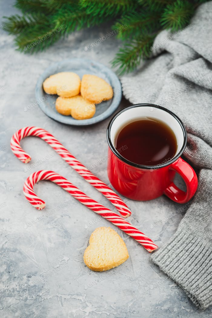 Yummy christmas cookies and a mug of hot tea, christmas time
