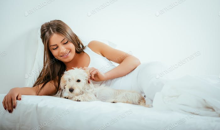 Girl And Dog In Bed