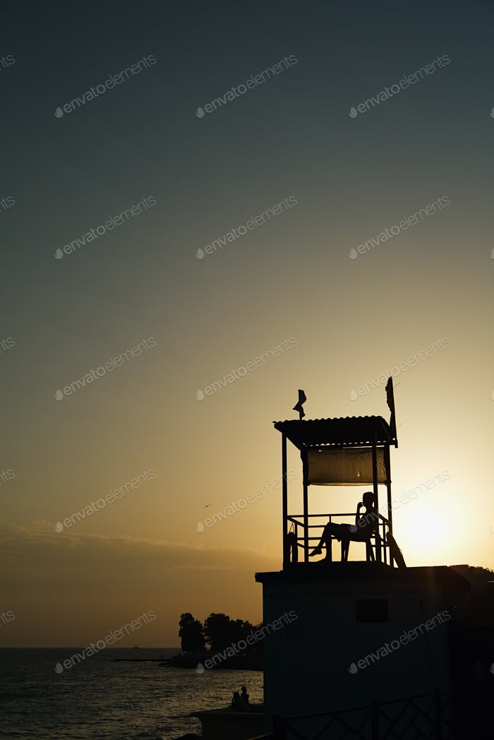 Anonymous person sitting in observation tower