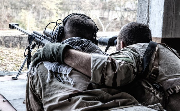 Army sniper team shooting from hidden position