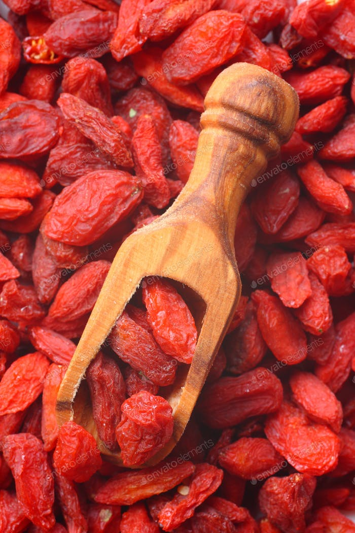 Goji berries in wooden scoop