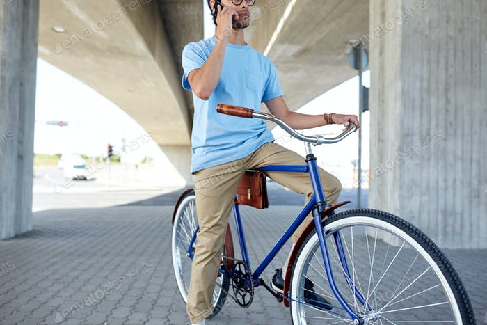 Thumbnail for man with smartphone and fixed gear bike on street