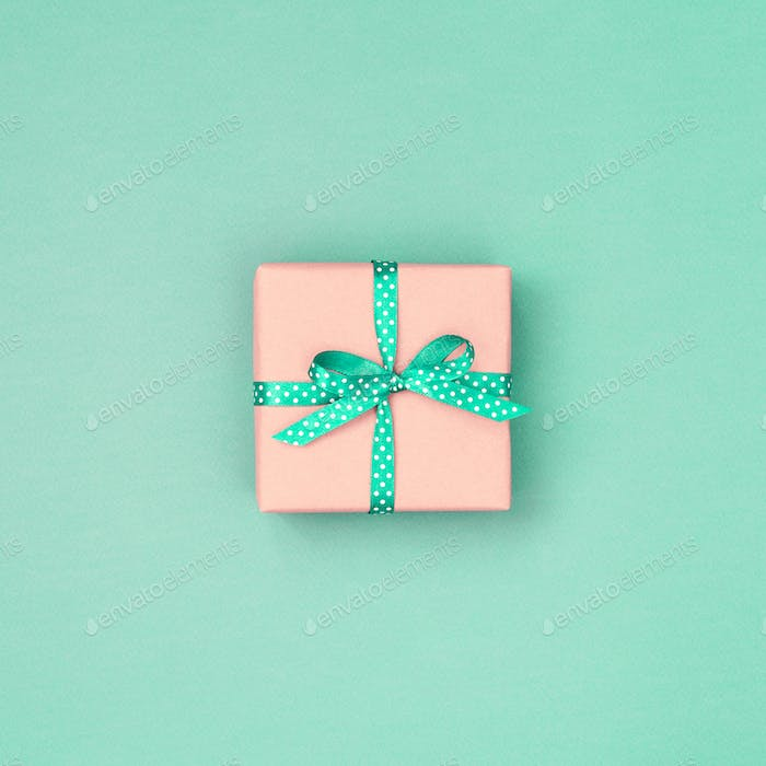 Gift Box with Bow on Mint Background.