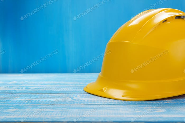 construction helmet on wooden table background