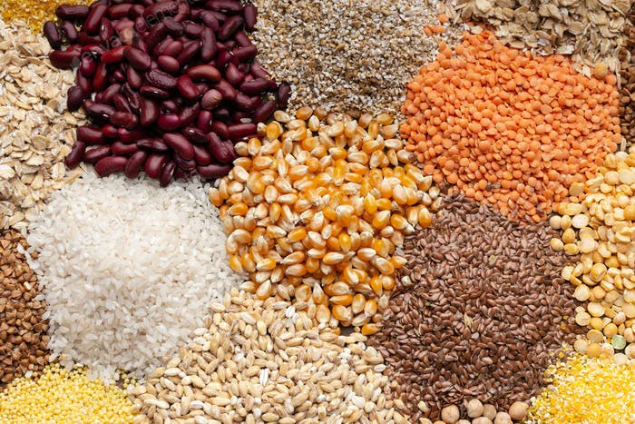 Close up of healthy grains, beans on background