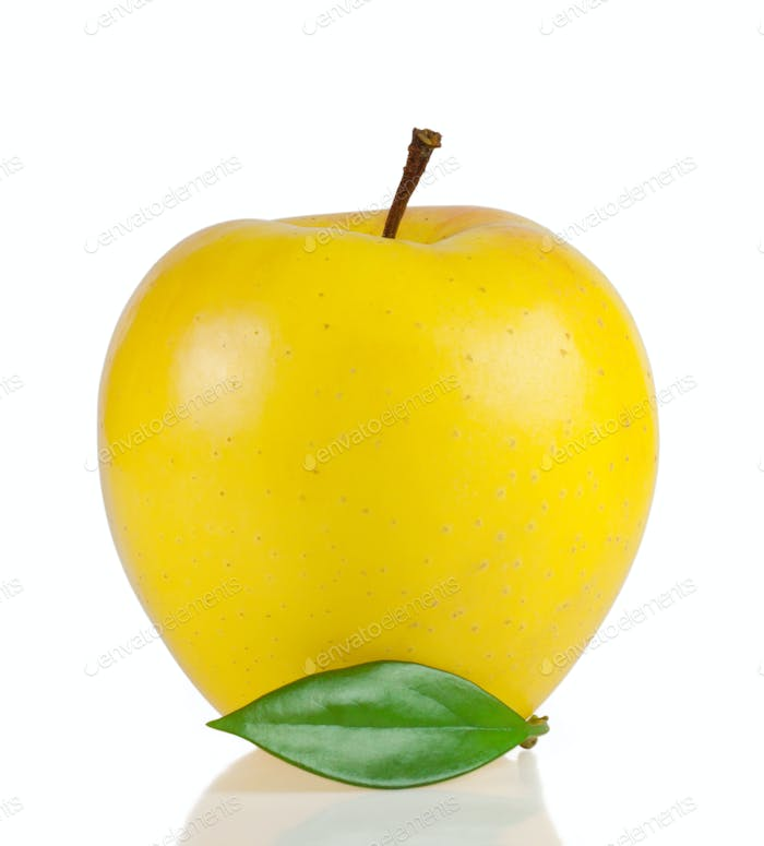 Yellow ripe apple with green leaf