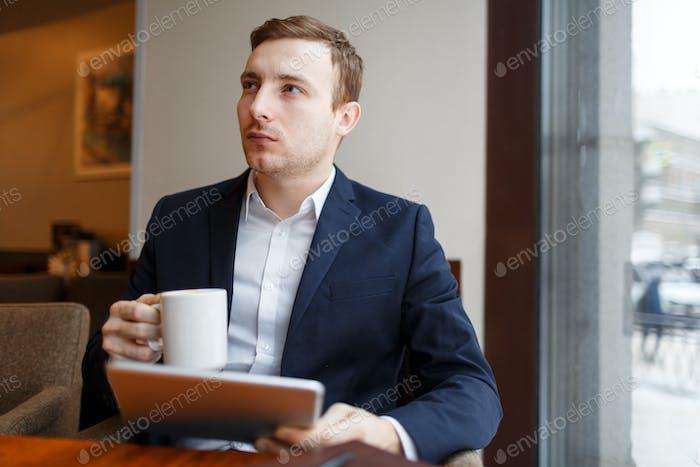 Banker in cafe